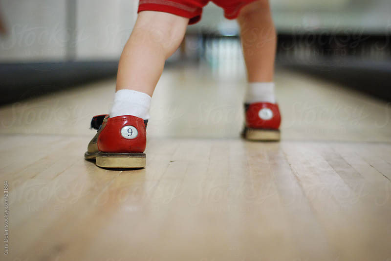 Boy wears size 9 Bowling Shoes by Cara Slifka for Stocksy United
