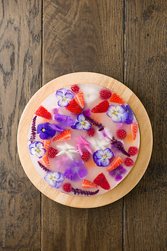 Jelly dessert with edible flowers and fruit by Kirsty Begg for Stocksy United