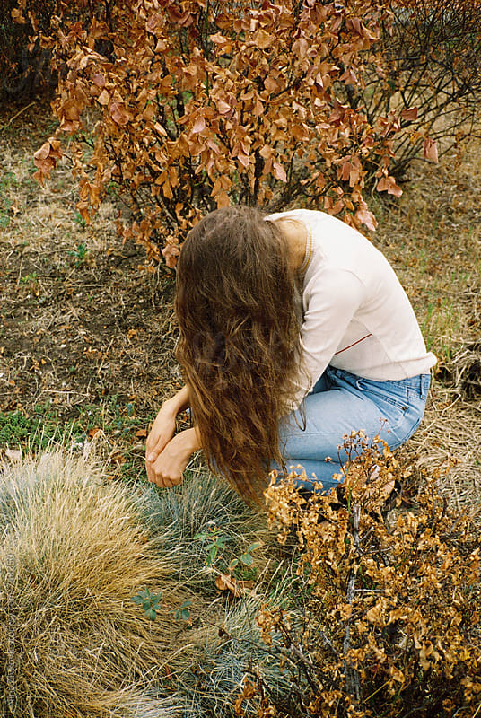 A long haired young woman in the autumn.  by Nina Zivkovic for Stocksy United