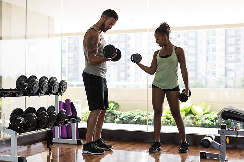Man and Woman Lifting Weights in the Gym by Mosuno for Stocksy United