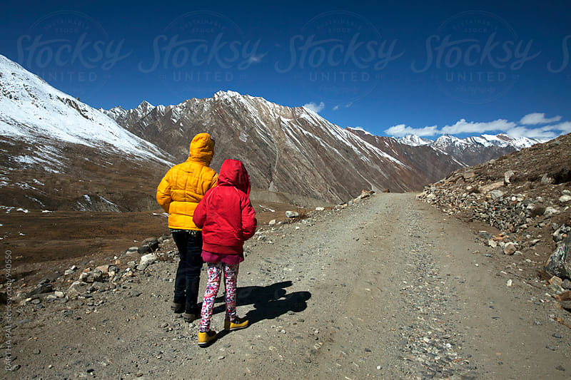 Mother and daughter walking through a high altitude mountain path by PARTHA PAL for Stocksy United