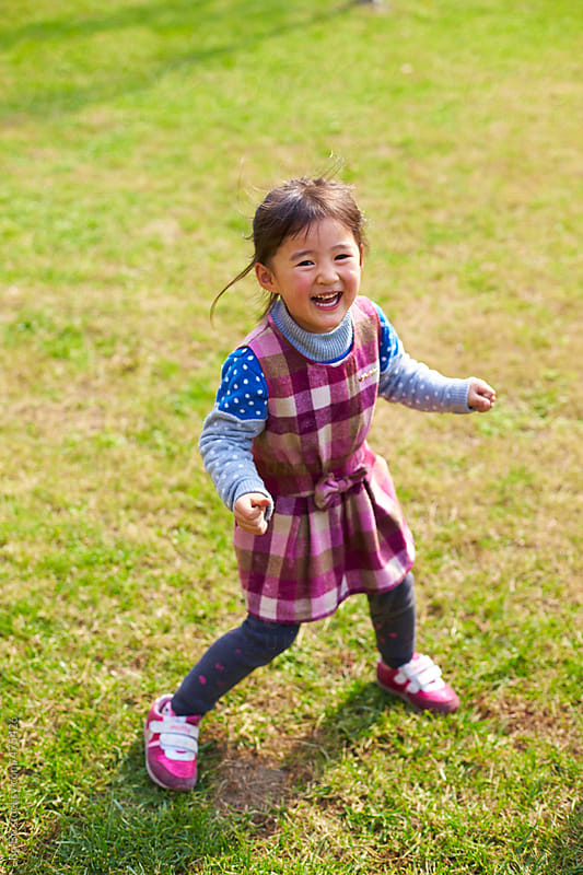 happy kid in the park by Bo Bo for Stocksy United
