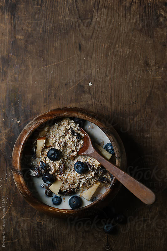 Muesli and fruit. by Darren Muir for Stocksy United