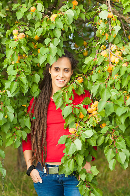 Portrait of a Woman in Apricot Trees by Mosuno for Stocksy United