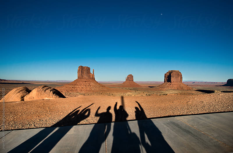 Shadow of 5 guys who went crazy in front of the panorama of the monument valley by Jean-Claude Manfredi for Stocksy United