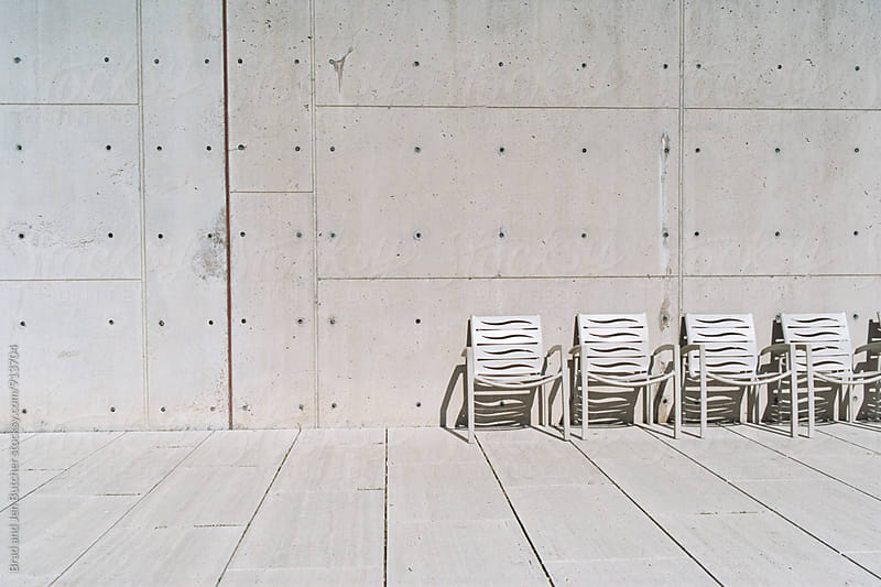 Empty Row of Chairs by Brad & Jen for Stocksy United