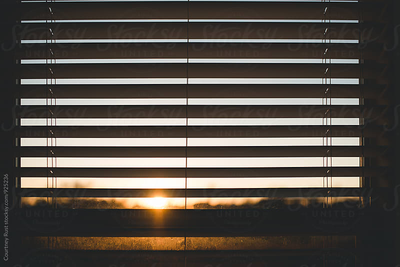 a window at sunset by Courtney Rust for Stocksy United