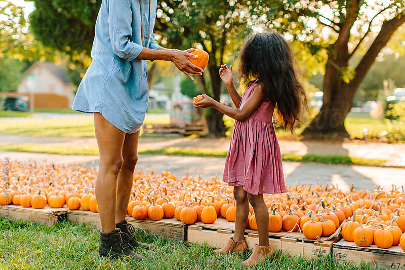 A mother & daugther at a pumpkin patch by Kristen Curette Hines for Stocksy United