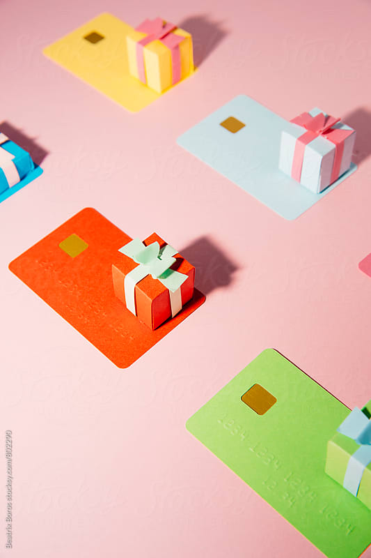 Shopping concept, credit cards and small gift boxes by Beatrix Boros for Stocksy United