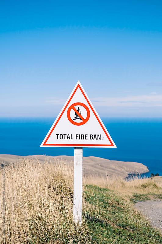 Total Fire Ban sign, Banks Peninsula, New Zealand. by Thomas Pickard for Stocksy United