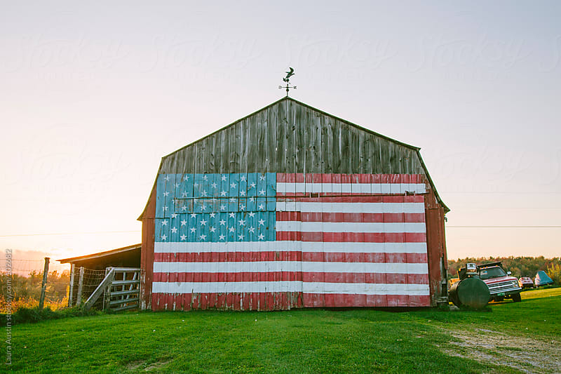 Vermont Barn With American Flag by Laura Austin for Stocksy United