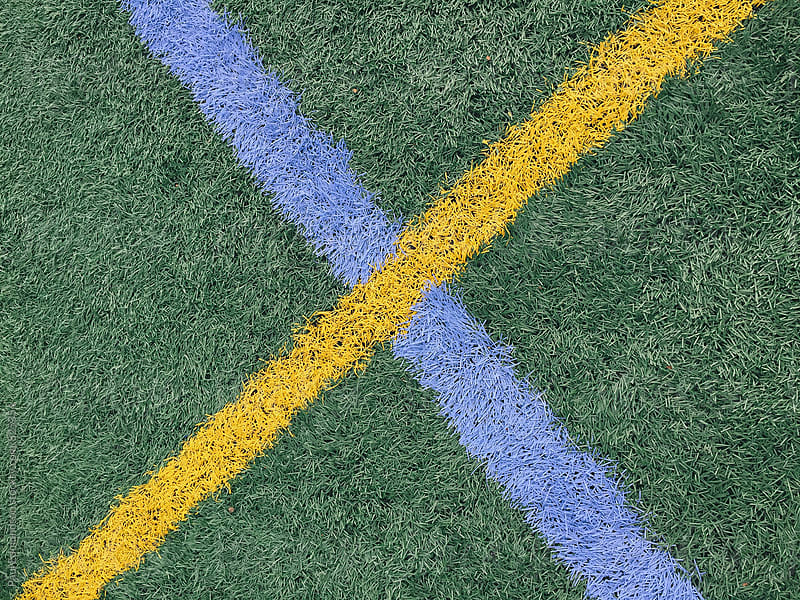 Colorful boundary lines on artificial turf sports field by Paul Edmondson for Stocksy United