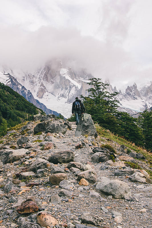 People hiking to a mountain on a trail with rocks in Patagonia, Argentina. by Alejandro Moreno de Carlos for Stocksy United