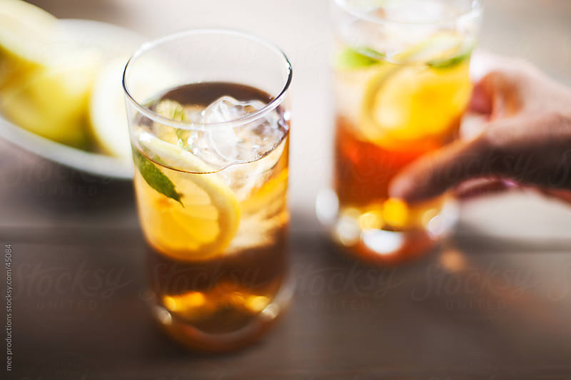 Ice tea on a summer day. by mee productions for Stocksy United