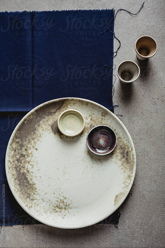 Ceramic plate with bowls and shots by Tatjana Ristanic for Stocksy United