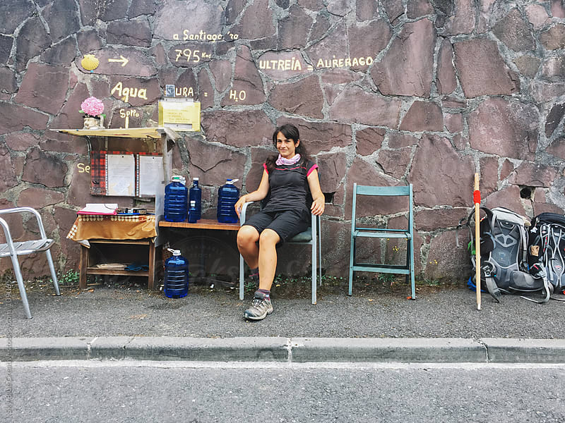 Woman having a break on the Camino de Santiago by Luca Pierro for Stocksy United