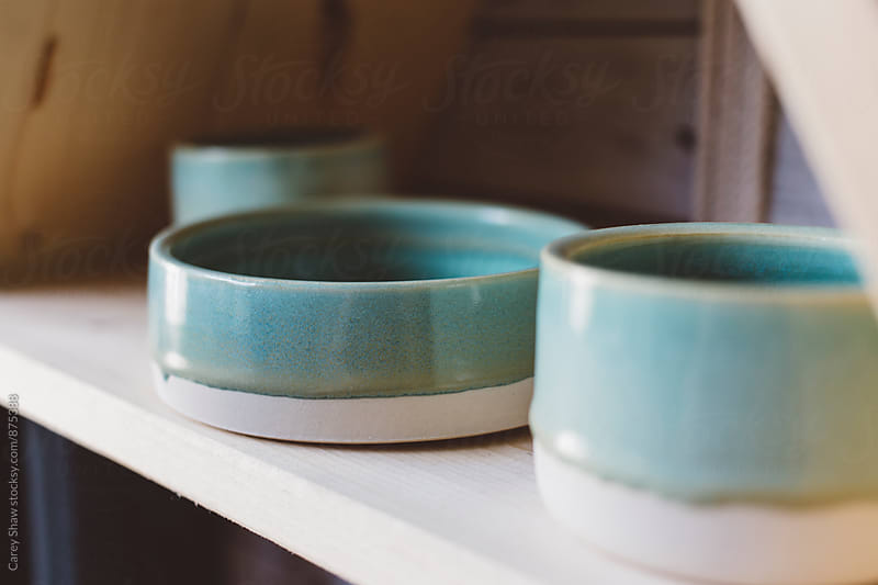 Handmade ceramic bowl on wood shelf by Carey Shaw for Stocksy United