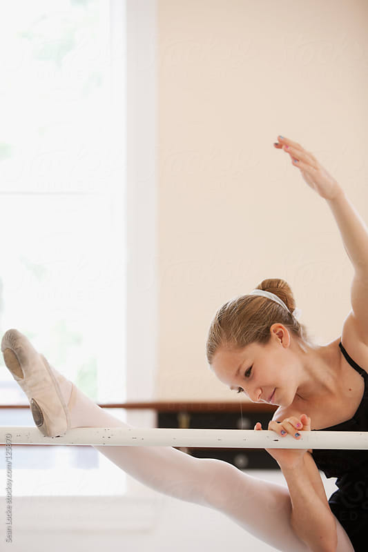 Ballet: Cute Pre-Teen Stretches at Barre by Sean Locke for Stocksy United