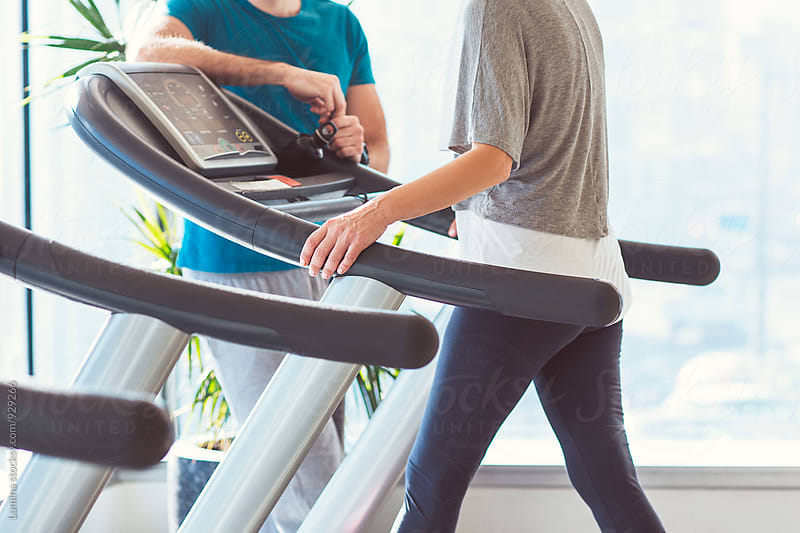 Woman Walking on a Treadmill by Lumina for Stocksy United