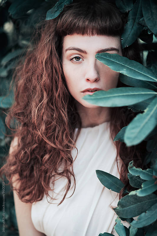 Portrait of a beautiful young woman with green eyes by Jovana Rikalo for Stocksy United