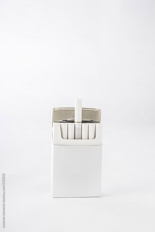 Cigarette Hard Pack 100's on White by suzanne clements for Stocksy United