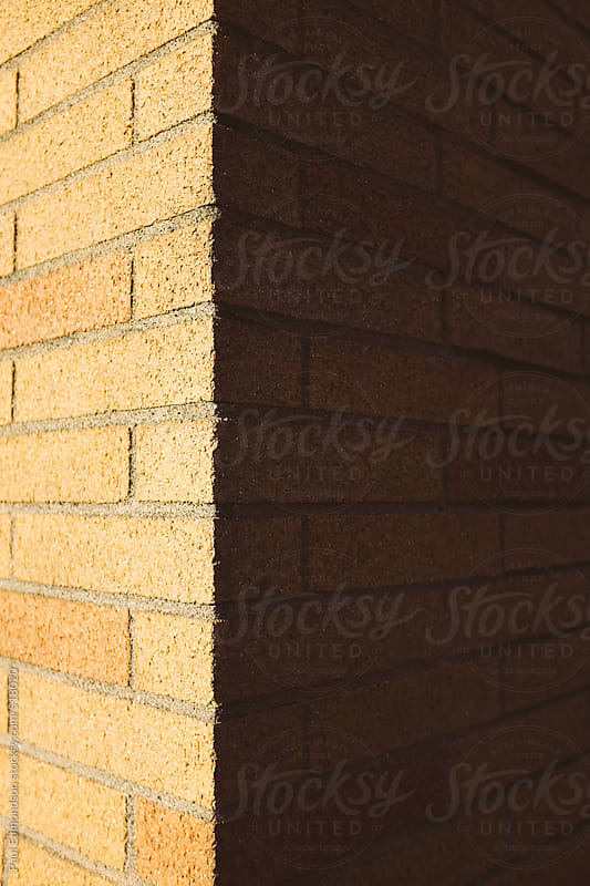 Corner of brick wall, casting shadow by Paul Edmondson for Stocksy United