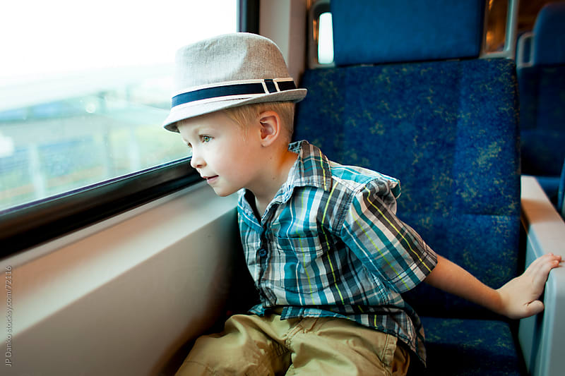 Little Boy Looking Out of Window On Commuter Train by JP Danko for Stocksy United