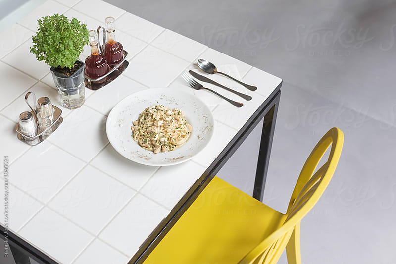 Delicious Pasta on the White Table by Branislav Jovanović for Stocksy United