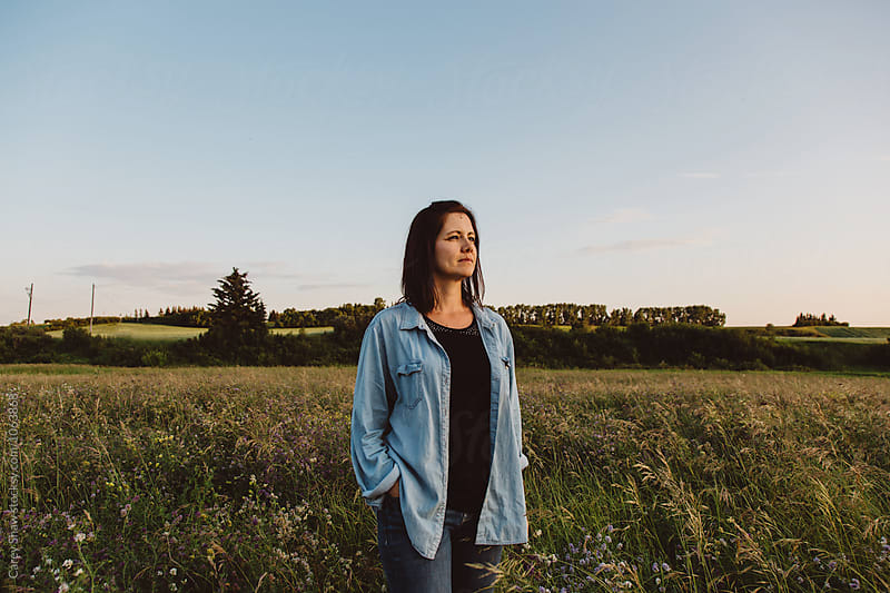 Beautiful Metis woman and countryside at dusk by Carey Shaw for Stocksy United