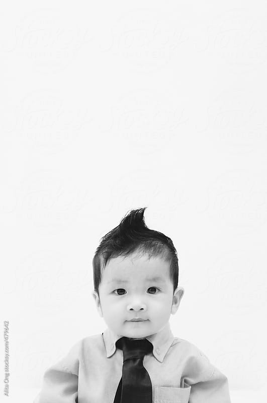 Baby wearing necktie looking at camera by Alita Ong for Stocksy United