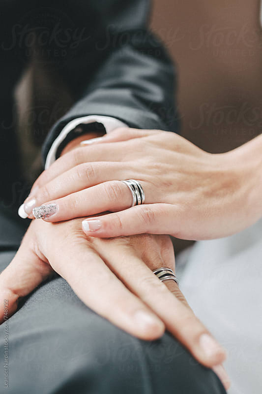 close up of bridal couple´s hands with wedding rings by Leander Nardin for Stocksy United