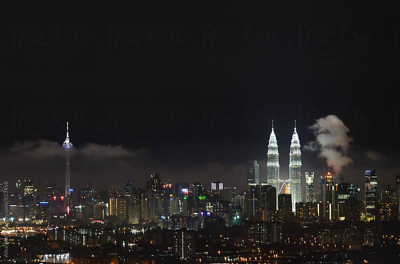 Night view to Kuala Lumpur cityline by Alice Nerr for Stocksy United