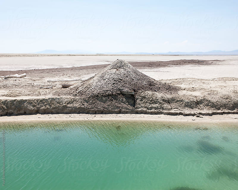 Canal and gravel pile from chloride mine, near Wendover, UT by Paul Edmondson for Stocksy United
