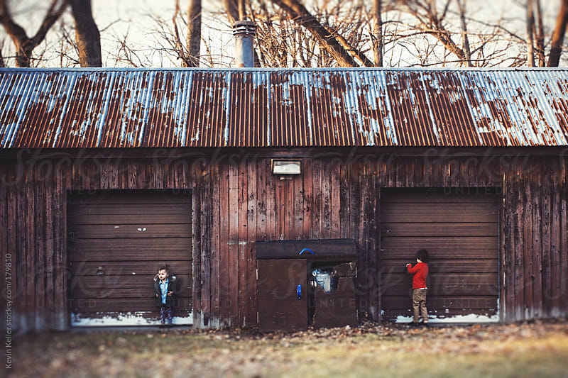Siblings Standing Outside Against an Old Building by Kevin Keller for Stocksy United