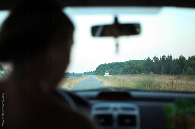 View of a country road from a car  by Marija Mandic for Stocksy United
