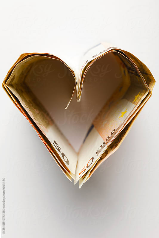 Heart made from fifty euro banknotes on white. by BONNINSTUDIO for Stocksy United