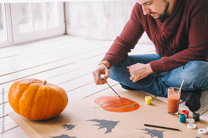 Man painting pumpkin with gouache by Danil Nevsky for Stocksy United
