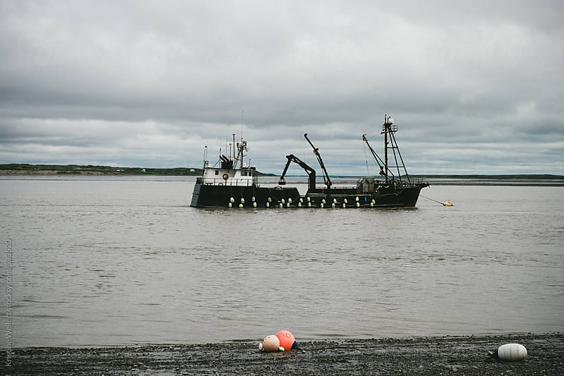 Black commercial fishing boat by Kristine Weilert for Stocksy United