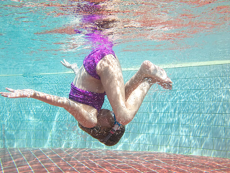 Little Girl Underwater Somersault In Sunny All Inclusive Luxury Resort Pool on Caribbean Vacation by JP Danko for Stocksy United