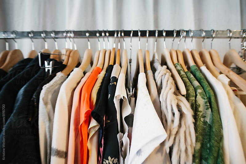 Colorful Clothes hanging on a Clothes Rack by We Are SISU for Stocksy United