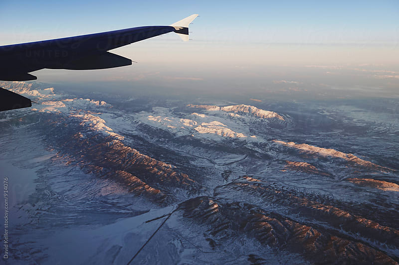 Flying over Utah During Sunrise by David Keller for Stocksy United
