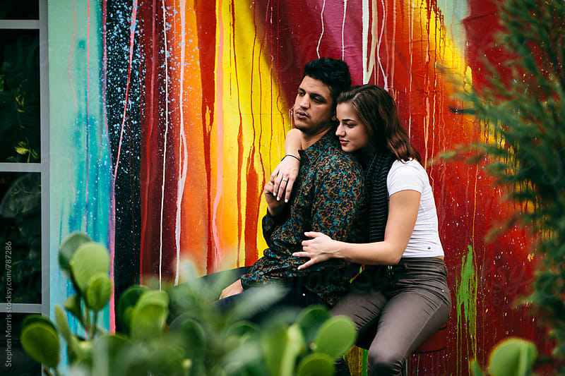 Young couple portrait by Stephen Morris for Stocksy United
