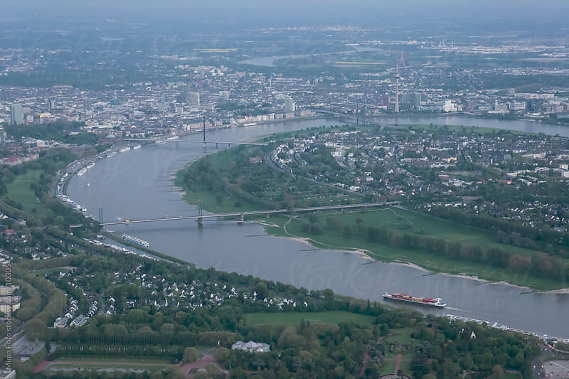 Aerial view on Rhein river bend at Duesseldorf, Germany by Mima Foto for Stocksy United
