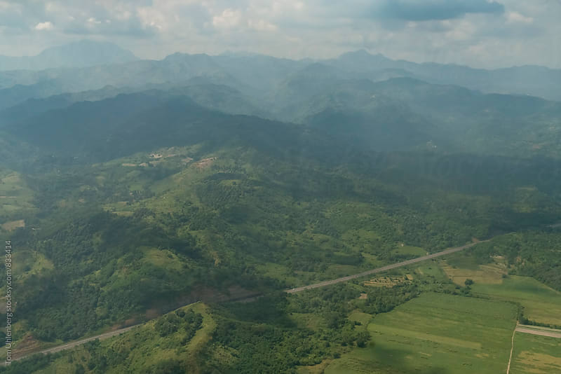 Flying over the hilly landscape of Luzon Island, the Philippines by Tom Uhlenberg for Stocksy United