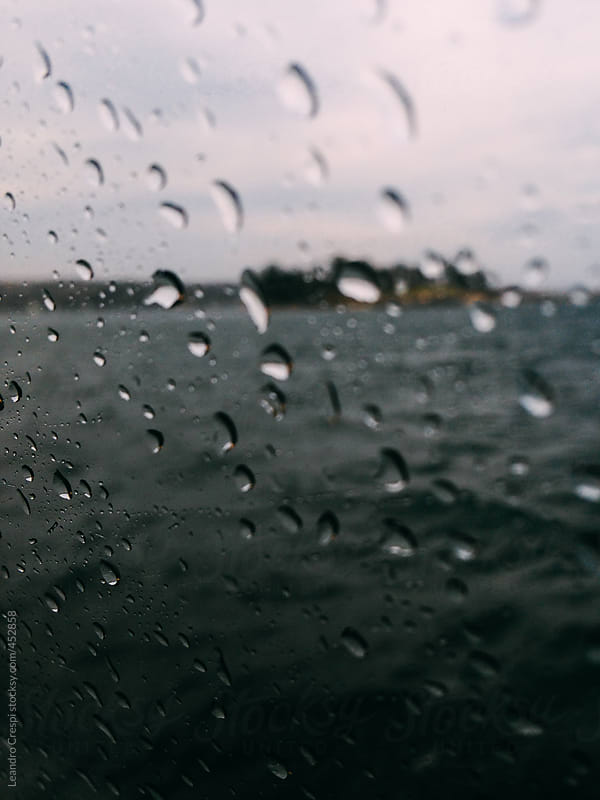 The sea behind a rained window by Leandro Crespi for Stocksy United