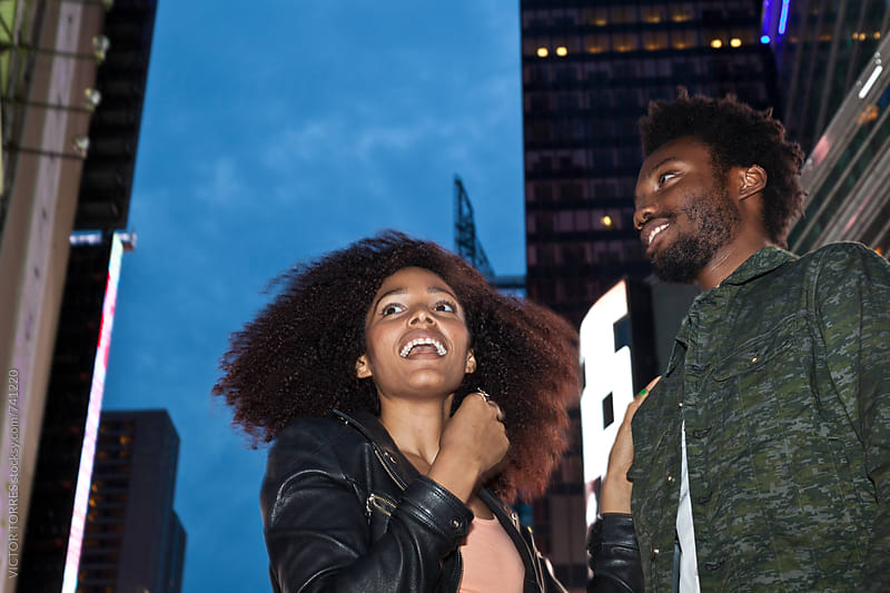 Afro American Couple Having Fun in the City of Manhattan by VICTOR TORRES for Stocksy United