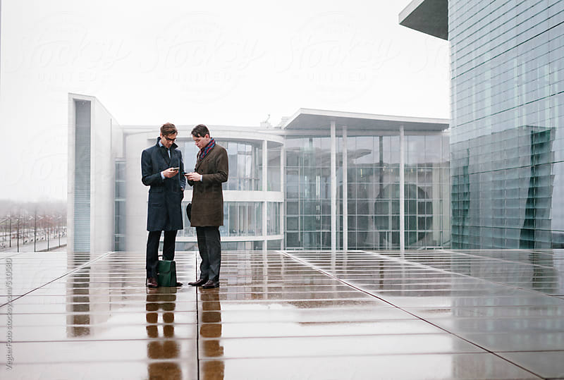 Two Businessmen having a meeting on a City Street by VegterFoto for Stocksy United