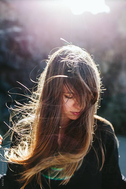 Portrait of a girl on a windy beach by KATIE + JOE for Stocksy United