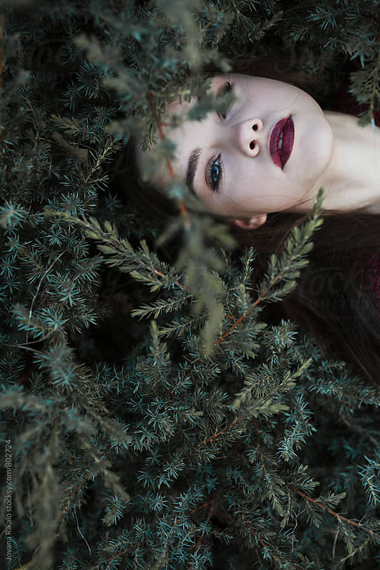 Girl lying in grass by Jovana Rikalo for Stocksy United