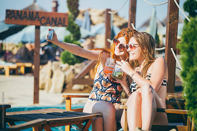 Girls Taking a Selfie at Beach Bar by Lumina for Stocksy United